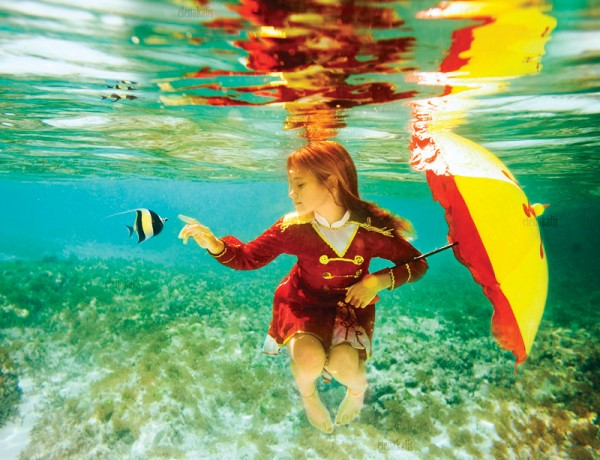 Water Underwater portraits blue colorful sun rays children couple breast