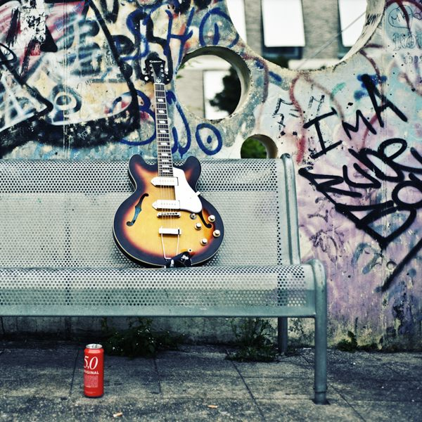 rock and roll guitar on bench
