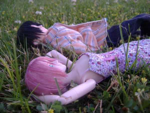 Two dolls in the garden.