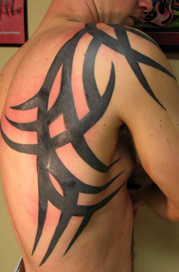 52 most eye catching tribal tattoos. Black Bedroom Furniture Sets. Home Design Ideas