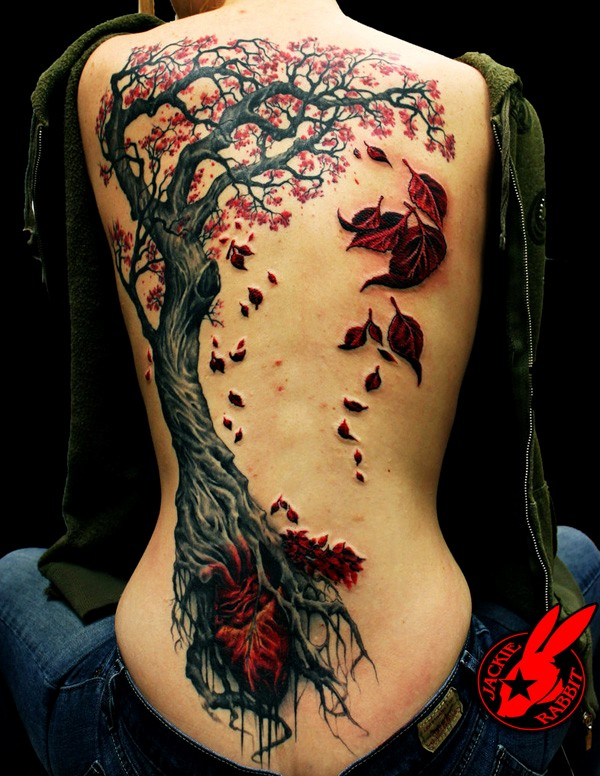 Full back female tattoo
