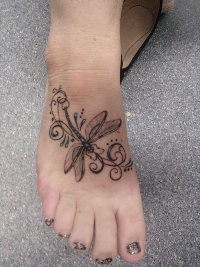 Simple dragonfly tattoo on the foot