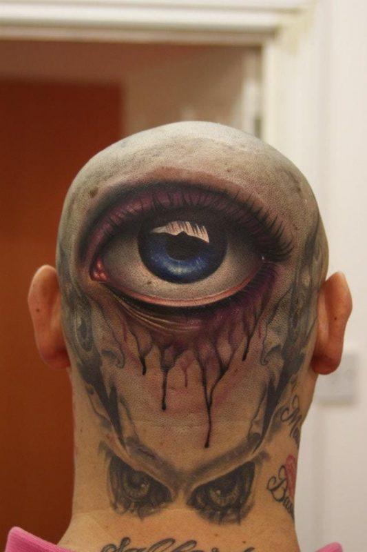 big eye on back of head tattoo