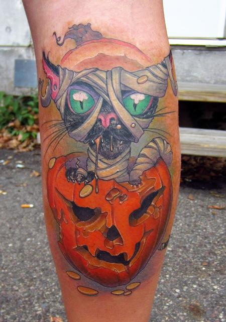 mummy cat sitting on cursed pumpkin tattoo